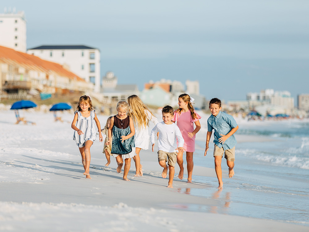 Kids running on the beach in Destin, FL